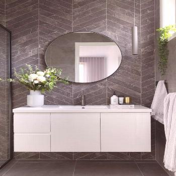 A modern ensuite, with marble look chevron tiles and concrete look floors. Round...#chevron
